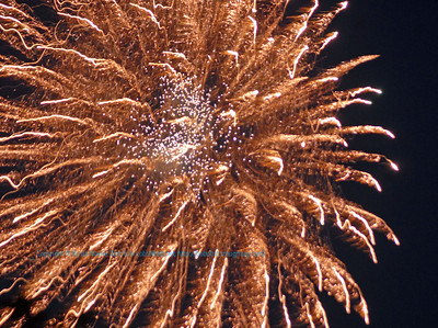 Orange fireworks fourth of July celebrations set the evening sky ablaze over White Lake Wisconsin (USA WI White Lake)