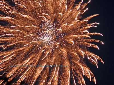 Orange fireworks fourth of July celebrations set the evening sky ablaze over White Lake Wisconsin (USA WI White Lake)