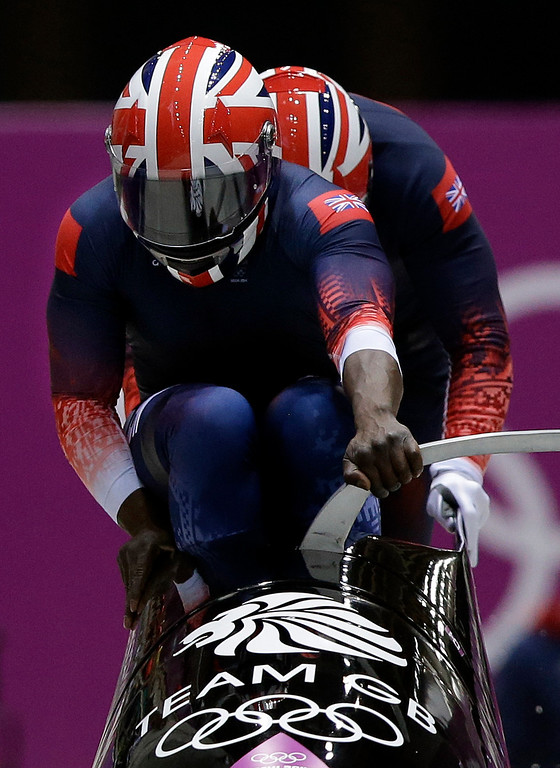 . The team from Great Britain GBR-1, piloted by Lamin Deen and brakeman John Baines, start their first run during the men\'s two-man bobsled competition at the 2014 Winter Olympics, Sunday, Feb. 16, 2014, in Krasnaya Polyana, Russia. (AP Photo/Dita Alangkara)