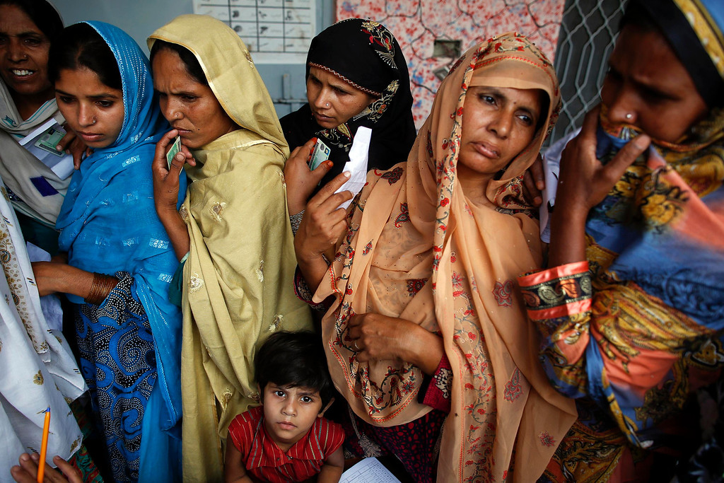 . Women wait to vote at a polling station in a village near Lahore May 11, 2013. A string of militant attacks cast a long shadow over Pakistan\'s general election on Saturday, but millions still turned out to vote in a landmark test of the troubled country\'s democracy. REUTERS/Damir Sagolj