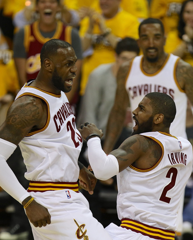 . Tim Phillis - The News-Herald LeBron James and Kyrie Irving celebrate during the first quarter on May 1 at Quicken Loans Arena.