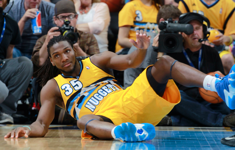 . Denver Nuggets forward Kenneth Faried tumbles on to the court after being fouled against the Utah Jazz in the fourth quarter of the Nuggets\' 101-94 victory in an NBA basketball game in Denver on Saturday, April 12, 2014. Faried scored 24 points and collected 21 rebounds to notch the first 20-20 game of his career. (AP Photo/David Zalubowski)