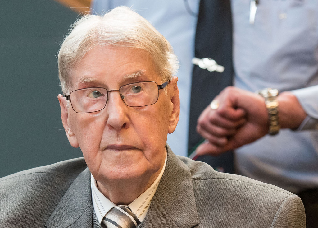 . 94-year-old former SS sergeant Reinhold Hanning who served as a guard at Auschwitz sits in the courtroom in Detmold, Friday, June 17, 2016. He has been found guilty of more than 170,000 counts of accessory to murder on allegations he helped the Nazi death camp kill 1.1 million Jews and others. Henning was sentenced to five years in prison. He died May 30 at age 95. (Bernd Thissen/Pool Photo via AP)