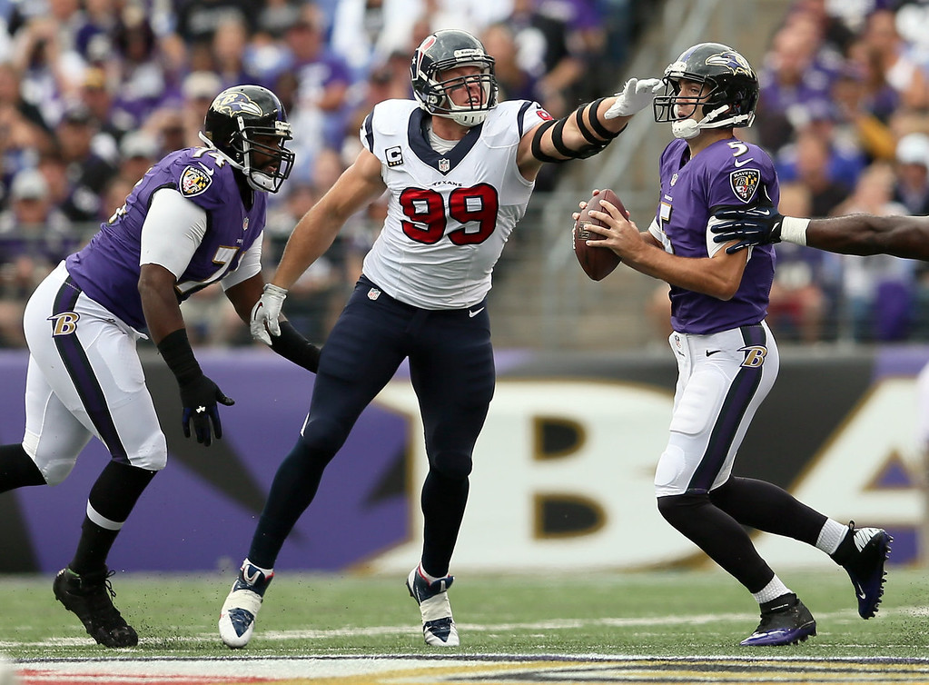 . Defensive end J.J. Watt #99 of the Houston Texans pressures quarterback Joe Flacco #5 of the Baltimore Ravens during the first half at M&T Bank Stadium on September 22, 2013 in Baltimore, Maryland.  (Photo by Rob Carr/Getty Images)