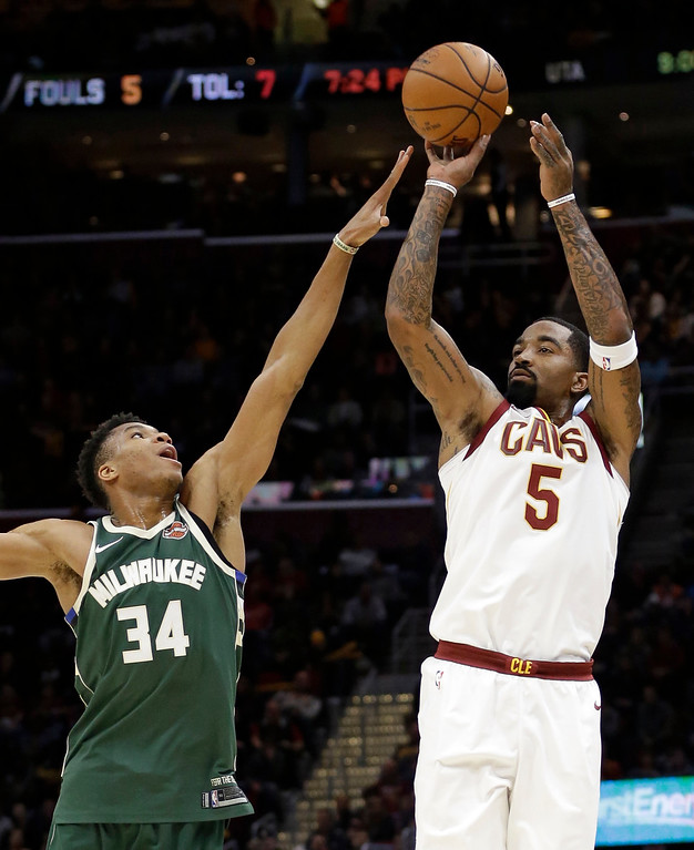 . Cleveland Cavaliers\' JR Smith (5) shoots over Milwaukee Bucks\' Giannis Antetokounmpo (34), from Greece, in the first half of an NBA basketball game, Tuesday, Nov. 7, 2017, in Cleveland. The Cavaliers won 124-119. (AP Photo/Tony Dejak)