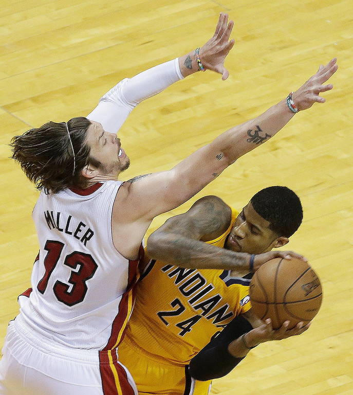 . Miami Heat shooting guard Mike Miller (13) defends against Indiana Pacers small forward Paul George (24) during the second half of Game 7 in their NBA basketball Eastern Conference finals playoff series, Monday, June 3, 2013 in Miami. (AP Photo/Wilfredo Lee)