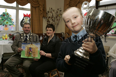 Cloughreagh House Primary Schools Art Competition. Overall winner  Wilson Moorehead a Primary 6 pupils from Windsor Hill P.S. is pictured with Deputy Mayor Martin Connolly and  Ms Nuala Gorman, Newry and Mourne Trust. 06W52N11