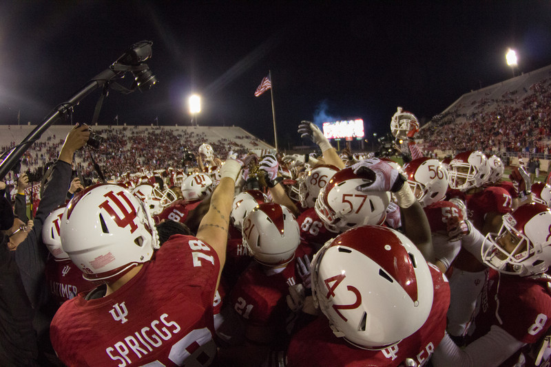 Members of the Indiana Hoosiers football team celebrate with the Old Oaken Bucket