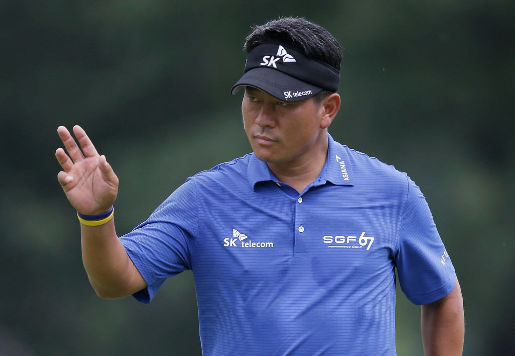 . K.J. Choi, of South Korea, waves after saving par on the ninth hole during the final round of the PGA Championship golf tournament at Oak Hill Country Club, Sunday, Aug. 11, 2013, in Pittsford, N.Y. (AP Photo/Charlie Neibergall)