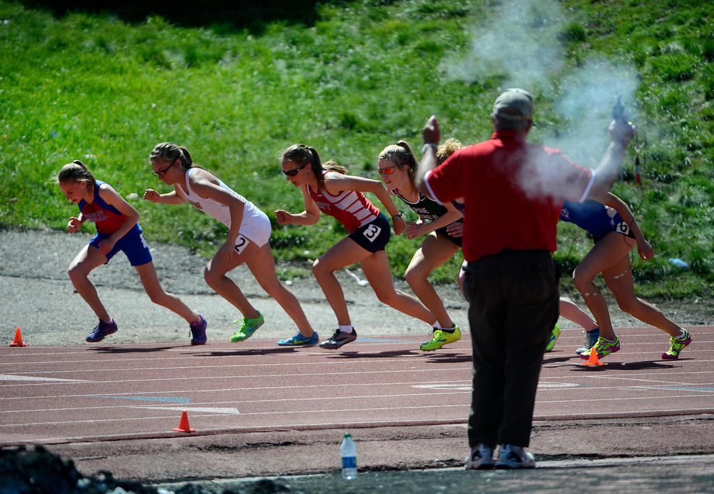 . LITTLETON, CO. - APRIL 27TH: Jordyn Colter, left, Cherry Creek,  leads fellow competitors at the start of the girls 800 meter during the Liberty Bell Track Meet at Littleton Public Schools Stadium Saturday, April 27th, 2013. Colter went on to win by a wide margin. (Photo By Andy Cross/The Denver Post)
