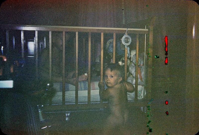 richard in crib baby susan outside crib.jpg