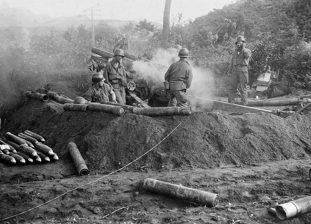 ". American GIs fire a 105 Howitzer gun in action against North Korean invaders somewhere in Korea. The war that began in Korea 60 years ago, on June 25, 1950, a ghastly conflict that killed millions and left the peninsula in ruins, became ""The Forgotten War\"" in many American minds. (AP Photo)"