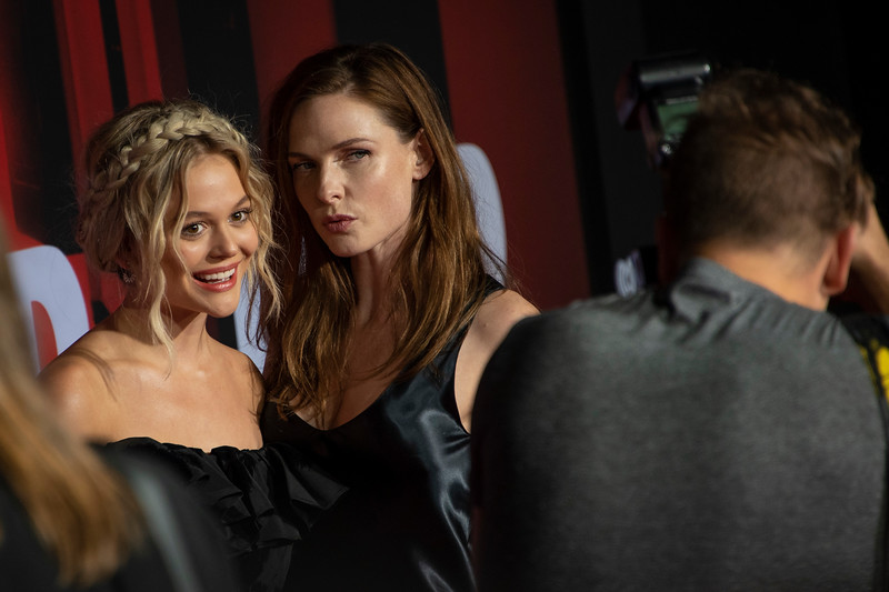 """LOS ANGELES, CALIFORNIA - OCTOBER 29: Emily Alyn Lind and Rebecca Ferguson attend the premiere of Warner Bros Pictures' """"Doctor Sleep"""" at Westwood Regency Theater on Tuesday October 29, 2019 in Los Angeles, California. (Photo by Tom Sorensen/Moovieboy Pictures,)"""