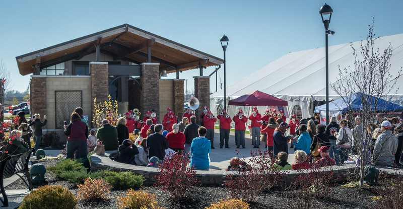 The pep rally took place next to a holiday gift market tent.  The sun was warm but the shade was chilly.