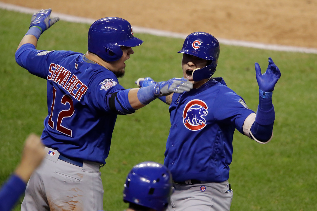 . Chicago Cubs\' Javier Baez celebrates his home run with Kyle Schwarber during the fifth inning of Game 7 of the Major League Baseball World Series against the Cleveland Indians Wednesday, Nov. 2, 2016, in Cleveland. (AP Photo/Gene J. Puskar)