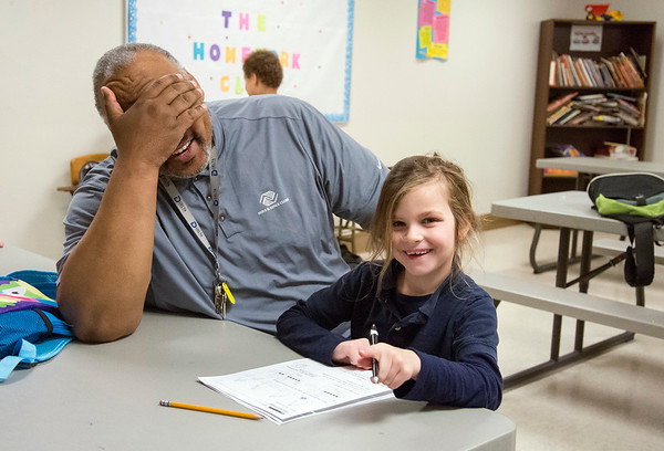 02/18/20 Wesley Bunnell | StaffrrBerwyn Kelley, the Senior Program Director of the New Britain Boys and Girls Club, laughs along with Aryana Jablon age 7, while helping her with math homework during Tuesday nights homework club.