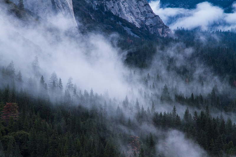 Mist hangs in the air at the base of El Capitan in Yosemite Valley