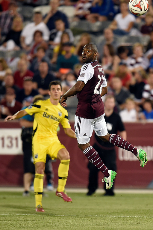 . Marvell Wynne #22 of the Colorado Rapids looks as a ball from the Columbus Crew sails past his head during an MLS match at Dick\'s Sporting Goods Park on July 4, 2014, in Commerce City, Colorado. The Rapids and Crew finished in a 1-1 draw. (Photo by Daniel Petty/The Denver Post)
