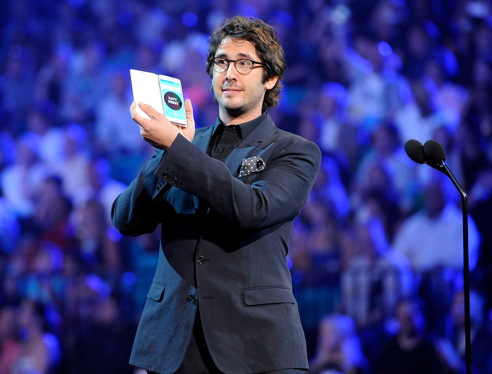 . Josh Groban presents the award for top female artist to Katy Perry at the Billboard Music Awards at the MGM Grand Garden Arena on Sunday, May 18, 2014, in Las Vegas. (Photo by Chris Pizzello/Invision/AP)