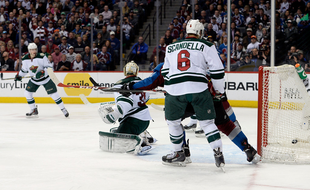 . Colorado Avalanche center Paul Stastny (26) gets the puck past Minnesota Wild goalie Darcy Kuemper (35) during the third period. This was the Avalanche third goal of the game.  (Photo by John Leyba/The Denver Post)