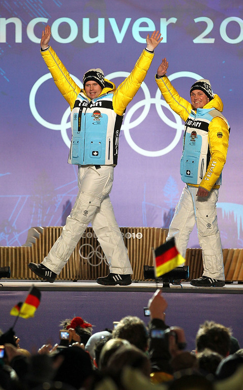 . Patric Leitner (L) and Alexander Resch (R) of Germany celebrate their bronze medal during the medal ceremony for the Menís Doublesí Luge on day 7 of the Vancouver 2010 Winter Olympics at Whistler Medals Plaza on February 18, 2010 in Whistler, Canada.  (Photo by Lars Baron/Bongarts/Getty Images)