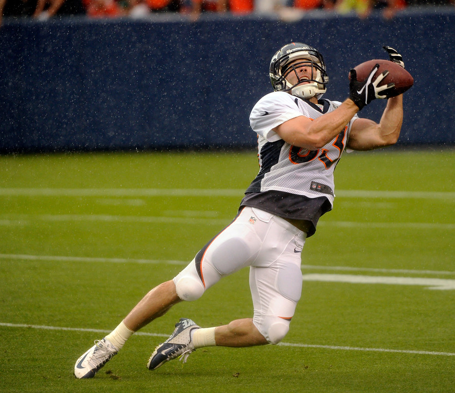 . DENVER, CO. - AUGUST 03: Receiver Wes Welker slipped on the wet turf but was still able to make a catch Saturday night in practice. The Denver Broncos practiced in the rain at Sports Authority Field Saturday night, August 3, 2013. Photo By Karl Gehring/The Denver Post