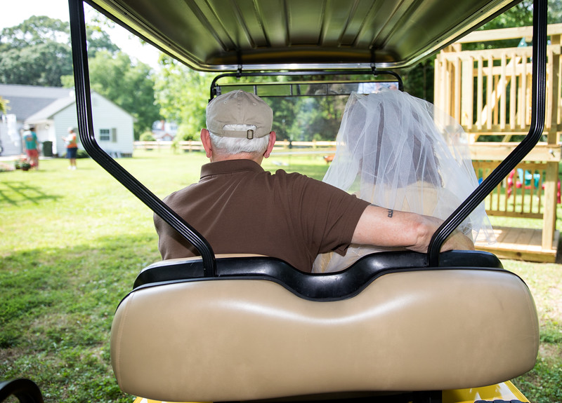 Mam and Badge on Golf Cart 2.jpg