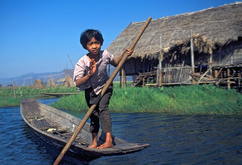 Girl Navigating Boat on Inle Lake in Burma