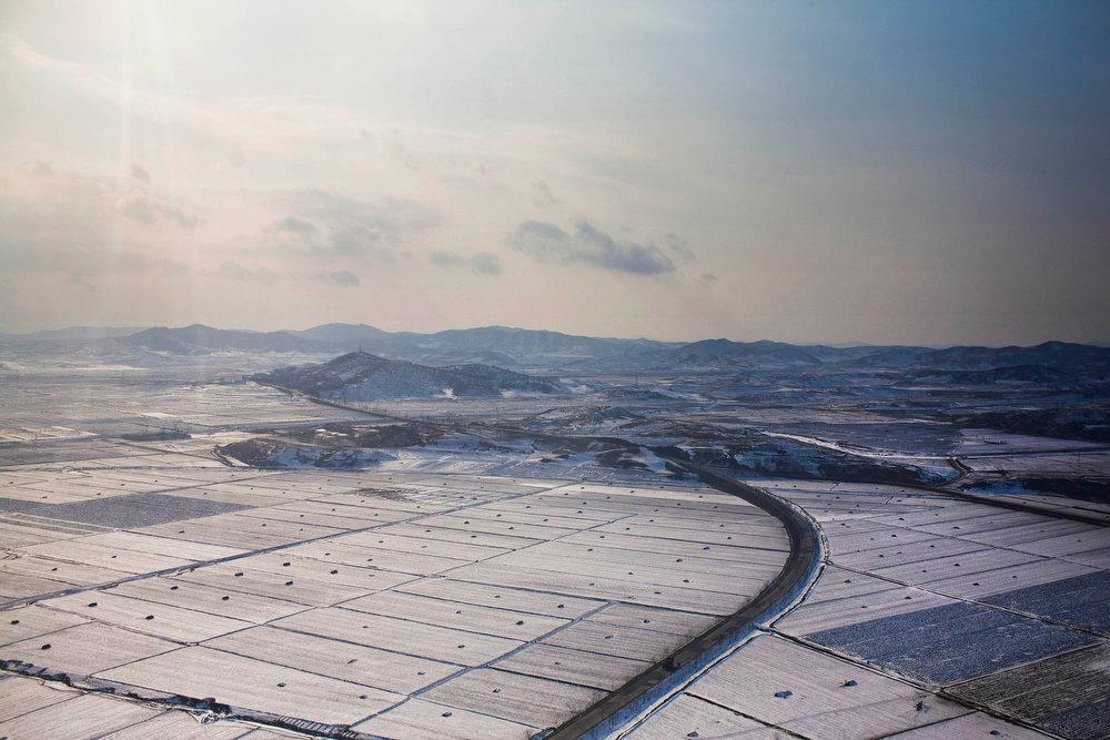 Description of . Snow blankets farm fields on the outskirts of Pyongyang, North Korea on Saturday, Feb. 11, 2012.  (AP Photo/David Guttenfelder)