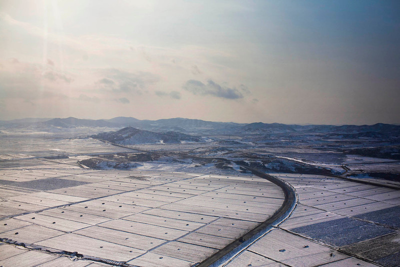 . Snow blankets farm fields on the outskirts of Pyongyang, North Korea on Saturday, Feb. 11, 2012.  (AP Photo/David Guttenfelder)