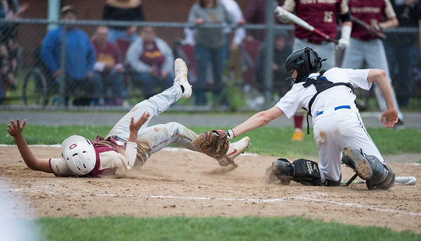 05/29/19 Wesley Bunnell | Staff New Britain and Southington baseball played to a 2-2 tie in the bottom of the 10th inning before the game was postponed due to rain. The game is scheduled to resume May 30th at 3:00pm. Catcher Jacob Delmonte (2) reaches for Danniel Rivera (1) in a close play at home.