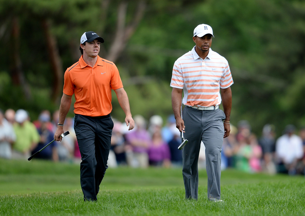 . (L-R) Rory McIlroy of Northern Ireland and Tiger Woods of the United States walk up the tenth hole during Round Two of the 113th U.S. Open at Merion Golf Club on June 14, 2013 in Ardmore, Pennsylvania.  (Photo by Ross Kinnaird/Getty Images)