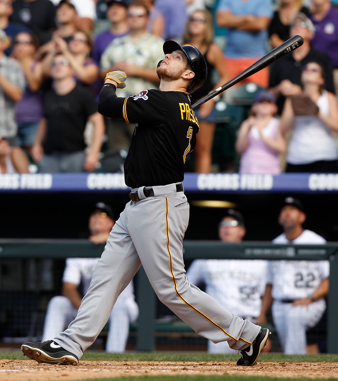 . Pittsburgh Pirates\' Alex Presley follows the flight of his out with the bases loaded against the Colorado Rockies to end the top of the ninth inning of the Rockies\' 3-2 victory in a baseball game in Denver, Sunday, Aug. 11, 2013. (AP Photo/David Zalubowski)