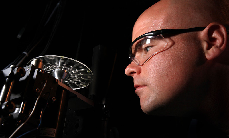 Researcher Greg Sommer and the Lab-On-A-Disc at Sandia National Lab in Livermore.