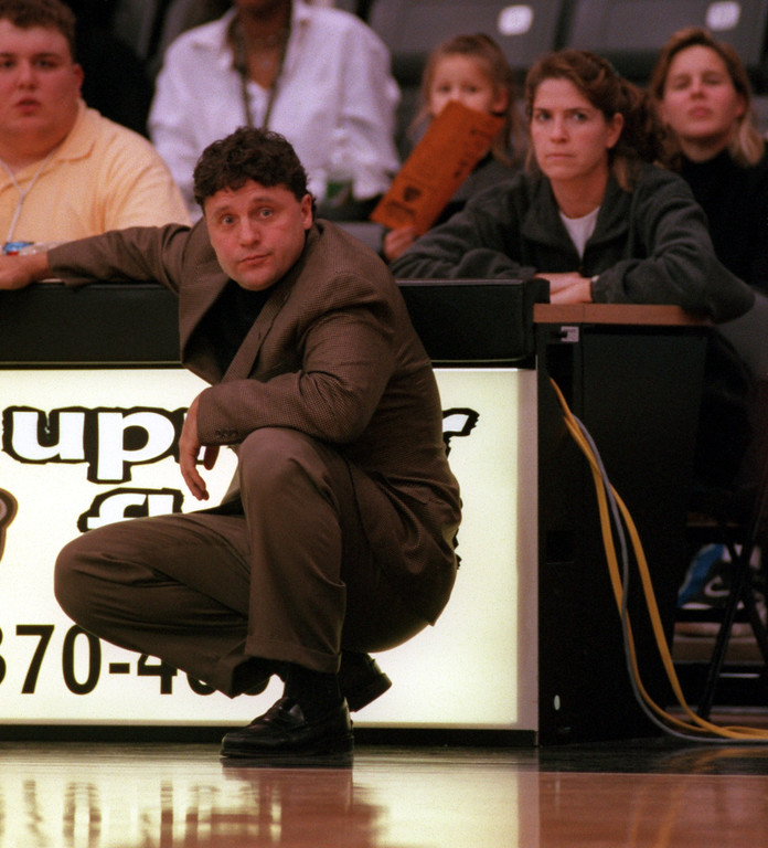 . Oakland University men\'s basketball head coach Greg Kampe (left) watches the action as women\'s basketball head coach Beckie Francis (right) observes the action as well, against Team Prestige during second half action, Monday, November 8, 1999.