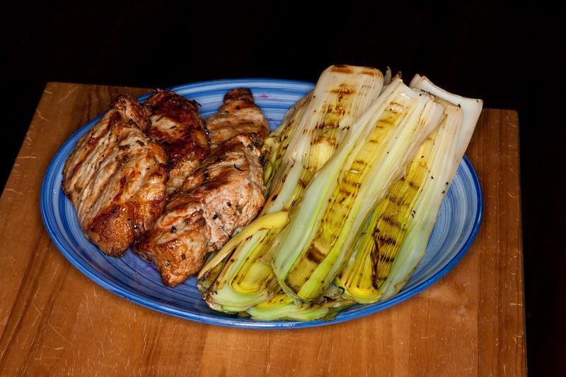 Grilled pork chops and leeks.
