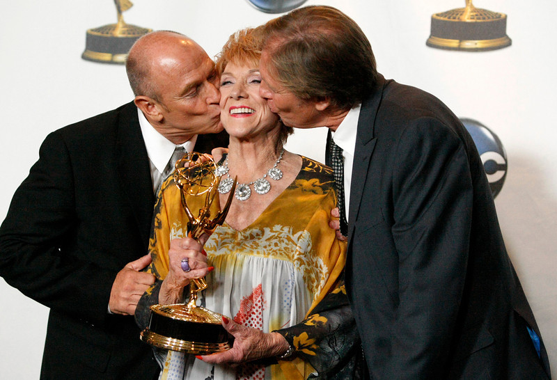 ". In this June 20, 2008 file photo, actress Jeanne Cooper, center, gets a kiss from Corbin Bernsen, left, and Collin Bernsen in the press room at the Daytime Emmy Awards in Los Angeles. CBS says soap opera star Jeanne Cooper has died. She was 84.  Cooper played grande dame Katherine Chancellor on CBS\' ""The Young and the Restless\"" for nearly four decades.  (AP Photo/Dan Steinberg, File)"