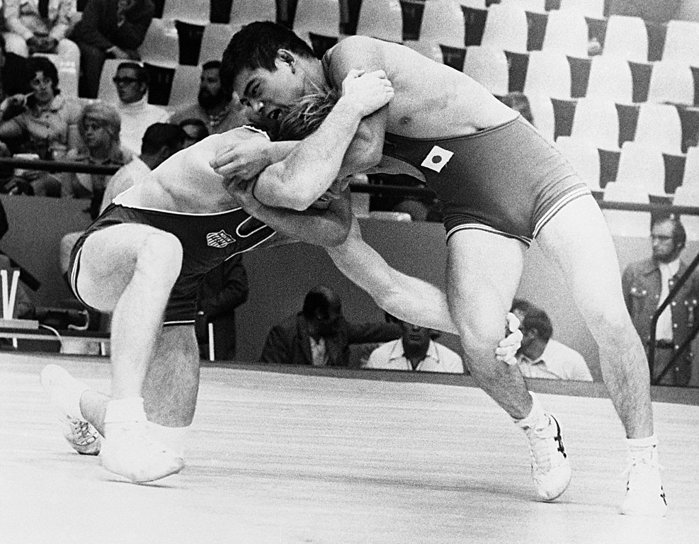 . Dan Gable of the USA wins over Kikuo Wada of Japan, right, in their meet during Olympic Wrestling Tournament in Munich on August 30, 1972. (AP Photo)