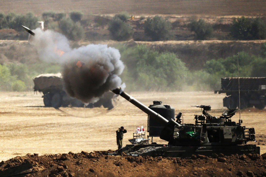 . An Israeli artillery gun fires a 155mm shell towards targets from their position near Israel\'s border with the Gaza Strip on July 30, 2014. Israel agreed to observe a four-hour lull in Gaza several hours after a deadly strike on a school killed 16, drawing a furious response from a UN refugee agency. AFP PHOTO/ JACK  GUEZ/AFP/Getty Images