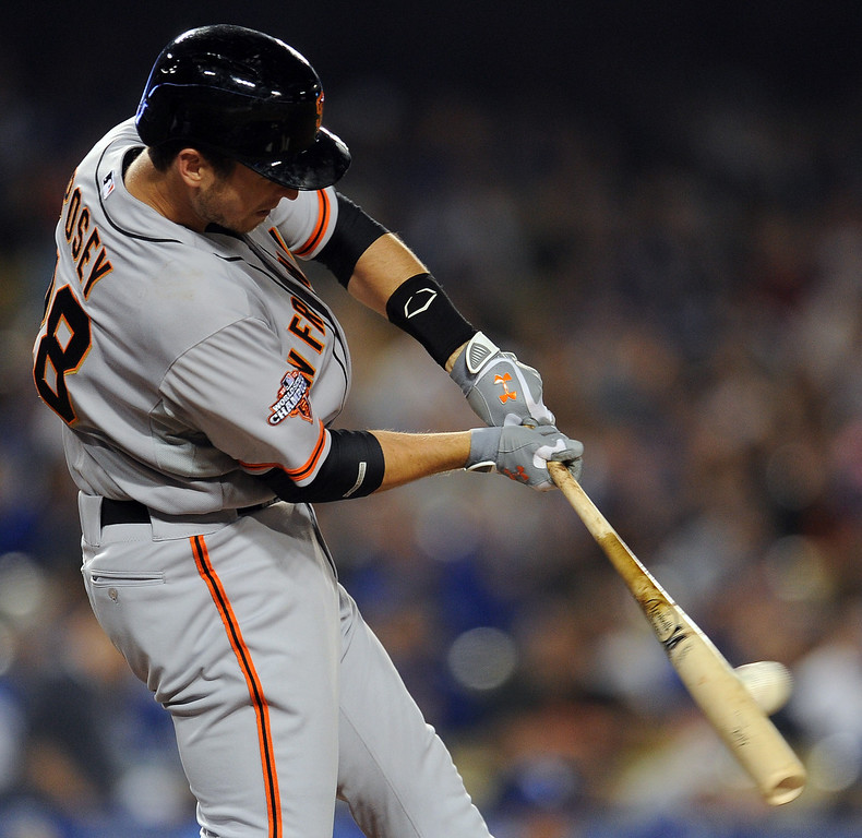 . San Francisco Giants\' Buster Posey singles in the second inning of their baseball game against the Los Angeles Dodgers on Wednesday, April 3, 2013 in Los Angeles. 