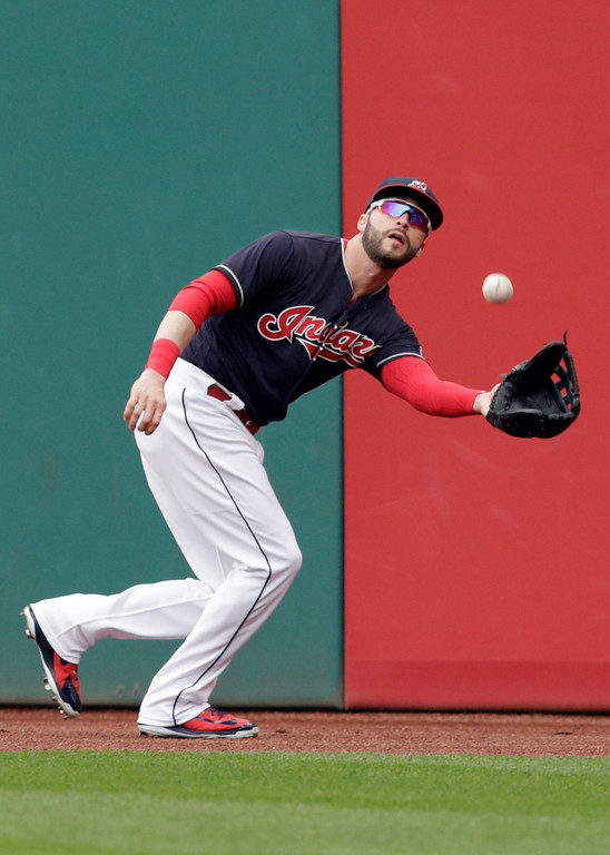 . Cleveland Indians\' Tyler Naquin catches a ball hit by Seattle Mariners\' David Freitas in the seventh inning of a baseball game, Saturday, April 28, 2018, in Cleveland. Freitas was out on the play. (AP Photo/Tony Dejak)