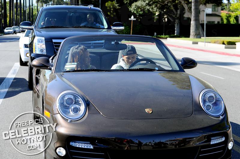 EXC: Chris Brown Takes Rihanna For A Spin In His Convertible Porsche!