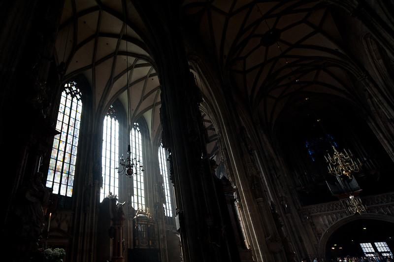 Sunlight coming through large windows in St. Stephen's Cathedra; - Vienna, Austria