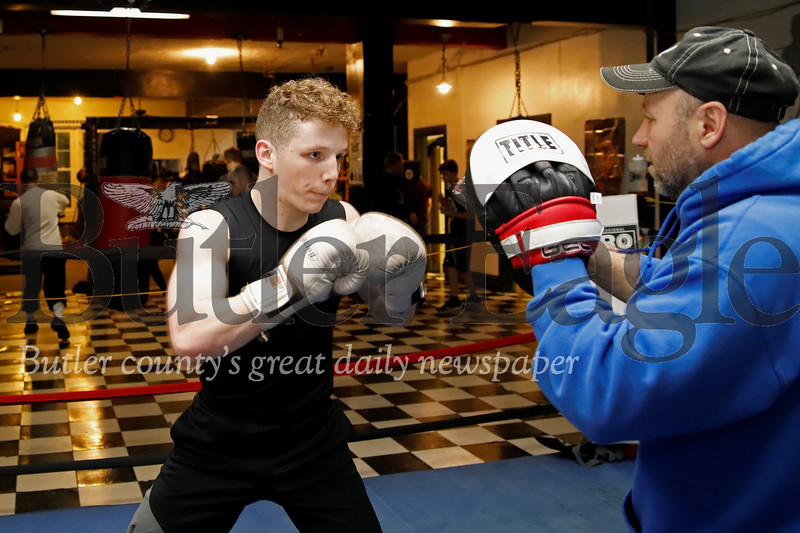 Butler Cubs boxer Isaac Guenther trains with coach Bill Wolfe. Seb Foltz/Butler Eagle 02/19/20