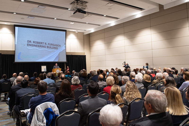 Attendees watch as the unveiling of the Furgason Engineering Building naming ceremony is shown via ballroom projectors on December 7, 2018 at Texas A&M University-Corpus Christi.