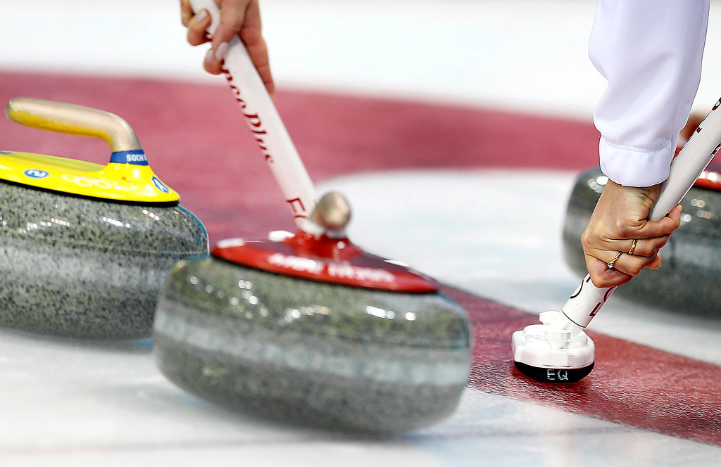 . Denmark\'s Helle Simonsen, right and Maria Poulsen, left, sweep the ice during the women\'s curling competition against Sweden at the 2014 Winter Olympics, Thursday, Feb. 13, 2014, in Sochi, Russia. (AP Photo/Wong Maye-E)