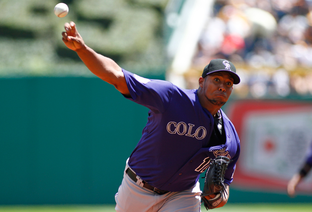 . Juan Nicasio #12 of the Colorado Rockies pitches in the first inning against the Pittsburgh Pirates during the game on August 4, 2013 at PNC Park in Pittsburgh, Pennsylvania.  (Photo by Justin K. Aller/Getty Images)