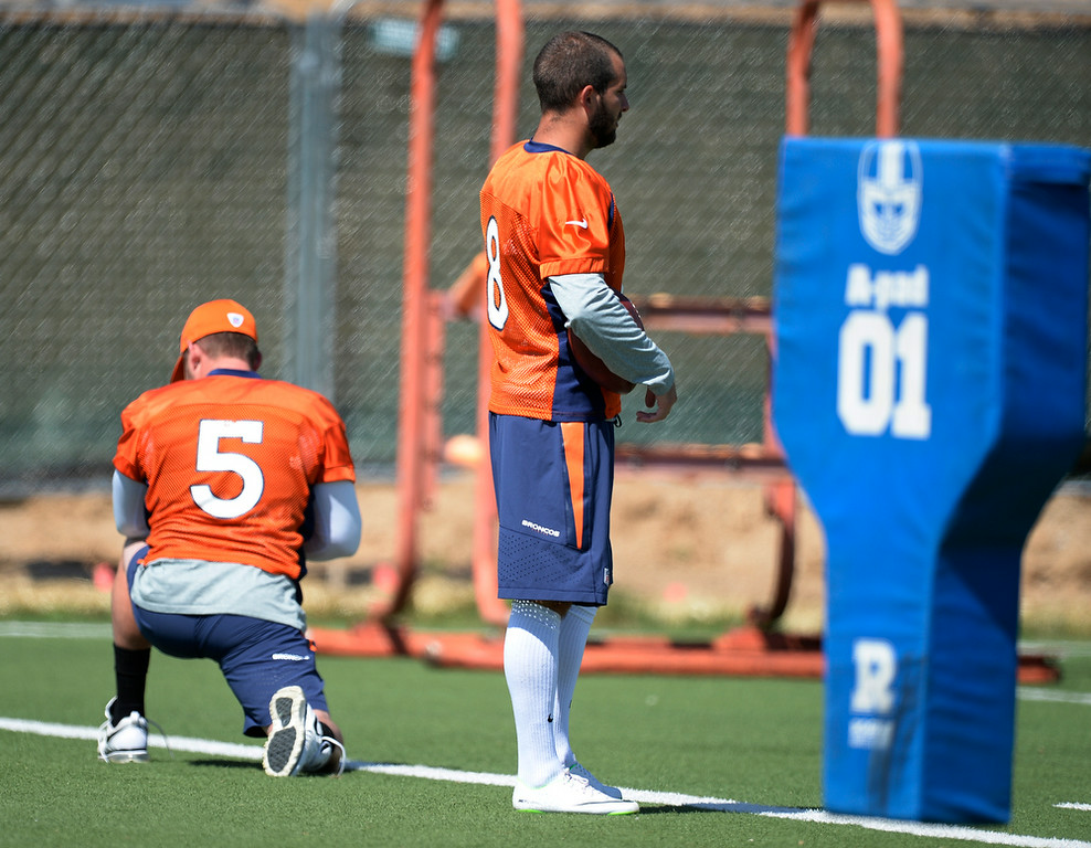 . Denver Broncos kicker Matt Prater (5) stretches as Denver Broncos kicker Mitch Ewald (8) looks on during drills at practice August 25, 2014 at Dove Valley.(Photo by John Leyba/The Denver Post)