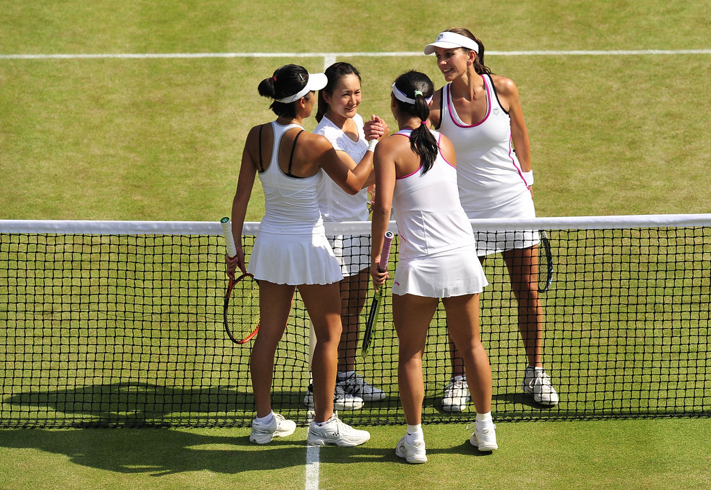 . Japan\'s Shuko Aoyama (2nd L) and South Africa\'s Chanelle Scheepers (R) congratulate China\'s Peng Shuai and Taiwan\'s Hsieh Su-Wei after they won their ladies doubles semi-final match on day eleven of the 2013 Wimbledon Championships tennis tournament at the All England Club in Wimbledon, southwest London, on July 5, 2013. GLYN KIRK/AFP/Getty Images