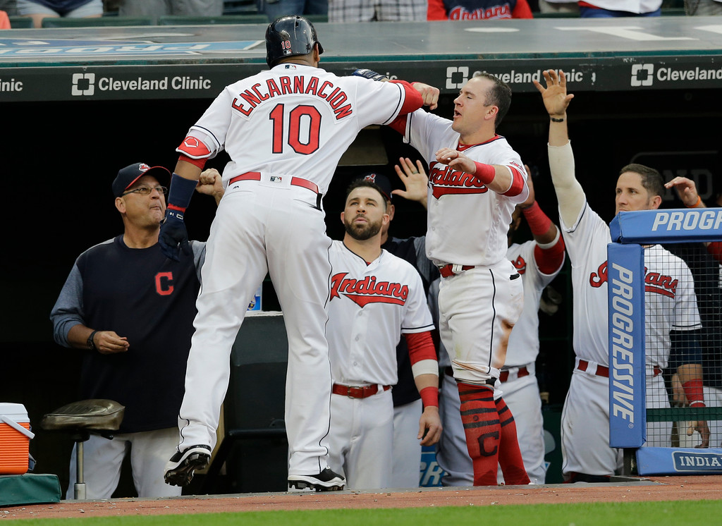 . Cleveland Indians\' Edwin Encarnacion, left, is congratulated by Daniel Robertson after Encarnacion hit a two-run home run off Chicago White Sox starting pitcher David Holmberg in the fourth inning of a baseball game, Saturday, June 10, 2017, in Cleveland. Michael Brantley scored on the play. (AP Photo/Tony Dejak)